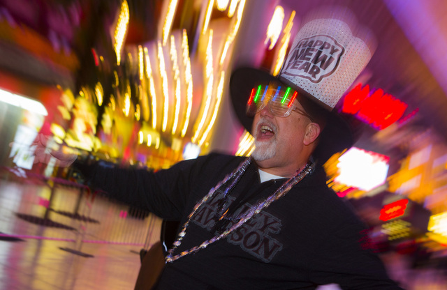 """D.J. McDonald from California dances during the """"Downtown Countdown"""" at Fremont Street Experience in this file photo. (Jeff Scheid/Las Vegas Review-Journal)"""
