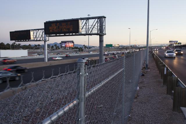 A sign advices motorists to report suspicious activity on Interstate 15 near Russell Road on Thursday, Dec. 29, 2016, in Las Vegas. Erik Verduzco/Las Vegas Review-Journal Follow @Erik_Verduzco