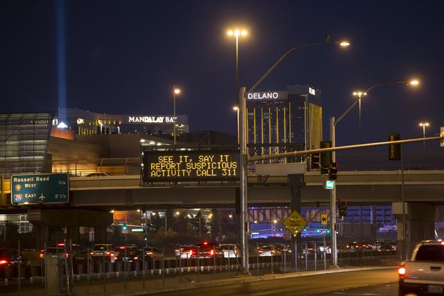 A sign advices motorists to report suspicious activity on Interstate 15 near Tropicana Avenue on Thursday, Dec. 29, 2016, in Las Vegas. Erik Verduzco/Las Vegas Review-Journal Follow @Erik_Verduzco