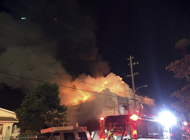 The scene of a fire in Oakland early Saturday, Dec. 3, 2016. The blaze began at about 11:30 p.m. on Friday during a party at a warehouse in the San Francisco Bay Area city.  (@seungylee14 via AP)