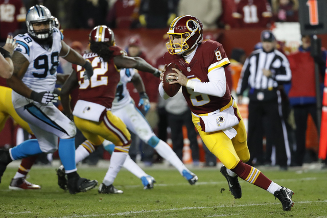 Washington Redskins quarterback Kirk Cousins (8) turns out of the pocket during the second half of an NFL game against the Carolina Panthers in Landover, Md., Monday, Dec. 19, 2016. (AP Photo/Alex ...