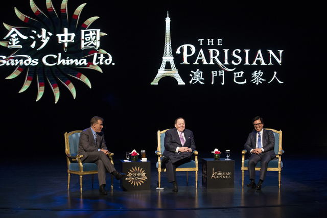 Las Vegas Sands Corp. president Robert Goldstein, from left, CEO Sheldon Adelson, and Wilfred Wong Ying Wai, president and chief operating officer for Sands China, participate in a press conferenc ...