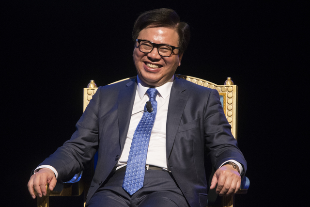 Wilfred Wong Ying Wai, president and chief operating officer for Sands China, participates during a press conference before the grand opening of Parisian, owned by Sands China Ltd., Tuesday, Sept. ...