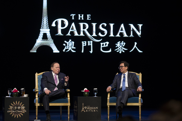 Las Vegas Sands Corp. Chairman and CEO Sheldon Adelson, left, and Wilfred Wong Ying Wai, president and chief operating officer for Sands China, participate during a press conference before the gra ...
