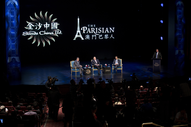 Las Vegas Sands Corp. president Robert Goldstein, left, CEO Sheldon Adelson, and Wilfred Wong Ying Wai, president and chief operating officer for Sands China, participate during a press conference ...