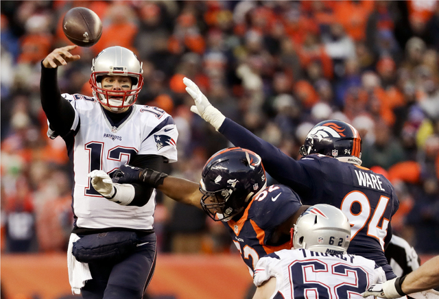 New England Patriots quarterback Tom Brady passes under pressure against the Denver Broncos during the second half Sunday, Dec. 18, 2016, in Denver. (AP Photo/Jack Dempsey)