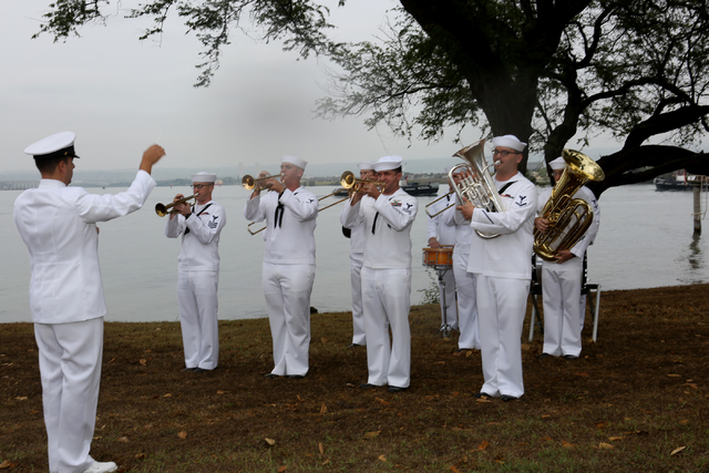 The Pacific Fleet Band performs the National Anthem on Thursday morning, December 8, 2016 at at Hospital Point where the USS Nevada was beached on December 7, 1941 during the surprise attack on Pe ...