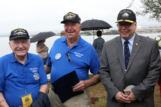 Richard (Dick) Ramsey, left, and Charles (Cliff) Burks, who both served on the USS Nevada pose for a photo with Samuel Cox, Director of Naval History and Heritage Command after the USS Nevada Comm ...