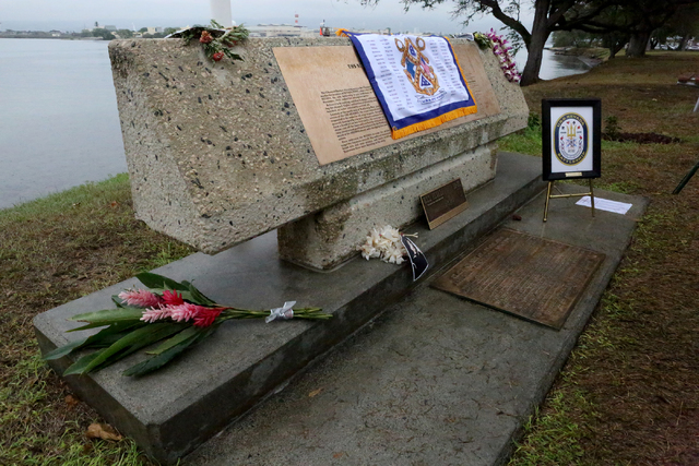 A battle flag, framed rope crest and a plaque from the state of Nevada are displayed on the marker at Hospital Point, where the USS Nevada was beached on December 7, 1941 during the surprise attac ...