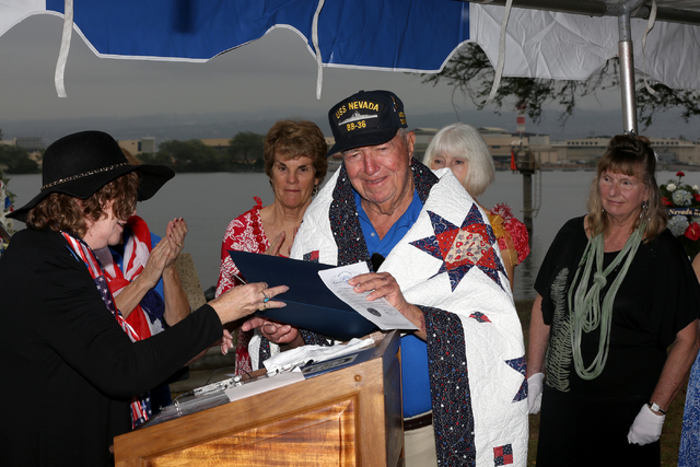 Linda Miller, left, and women of the Nevada DAR present Charles (Cliff) Burks with a custom made quilt at the USS Nevada Commemoration ceremony on the morning of Thursday, December 8, 2016 at Hosp ...