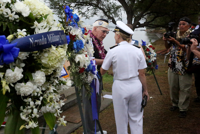 Pearl Harbor Survivor, Geb Galle, left, who was onboard the USS Nevada on the morning of December 7, 1941, speaks with Navy officer Lt. Dawn Stankus after the USS Nevada Commemoration ceremony at  ...
