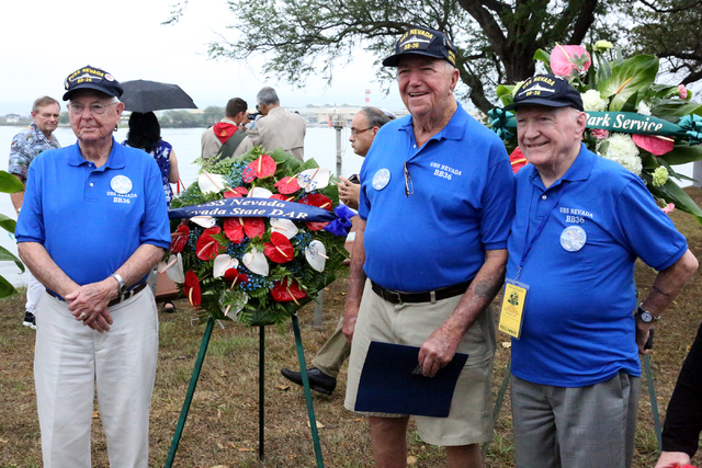 USS Nevada veterans, Ansel Tupper, left, Charles (Cliff) Burks and Richard (Dick) Ramsey, stand next to the wreath sent by the Nevada State DAR for the USS Nevada Commemoration ceremony at Hospita ...