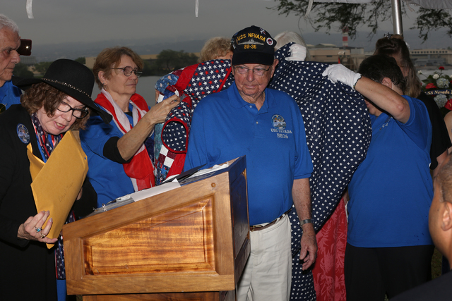 Linda Miller, left, and women of the Nevada DAR present USS Nevada veteran, Ansel Tupper, with a custom made quilt at the USS Nevada Commemoration ceremony on the morning of Thursday, December 8,  ...