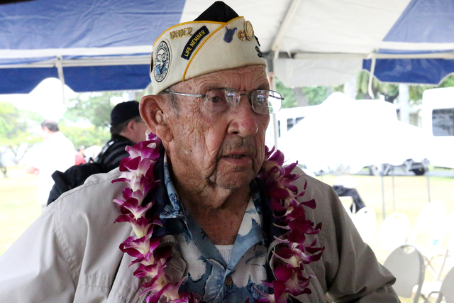 During the USS Nevada Commemoration ceremony on the morning of Thursday, December 8, 2016 at Hospital Point, Pearl Harbor Survivor, Wetzel Sanders, of Midriff West Virginia tells how he shot down  ...