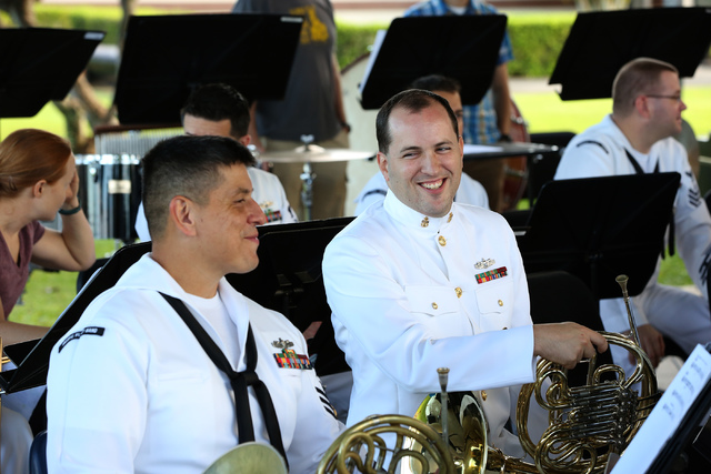 Petty Officer First Class Eddie Hernandez, left, and Chief petty Officer David Baine share a chuckle during rehearsal with the U.S. Pacific Fleet Band as part of the 75th Pearl Harbor Commemoratio ...