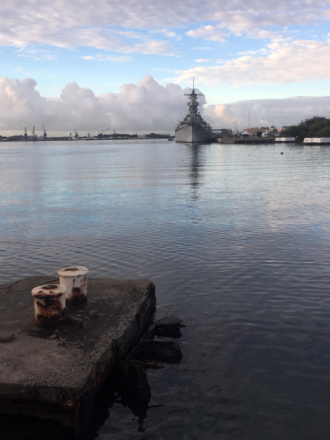 The USS Missouri sits in Pearl Harbor, Hawaii, Monday, Dec. 5, 2016, as seen from the sunken USS Arizona memorial where the Navy and National Park Service will commemorate the 75th anniversary Wed ...
