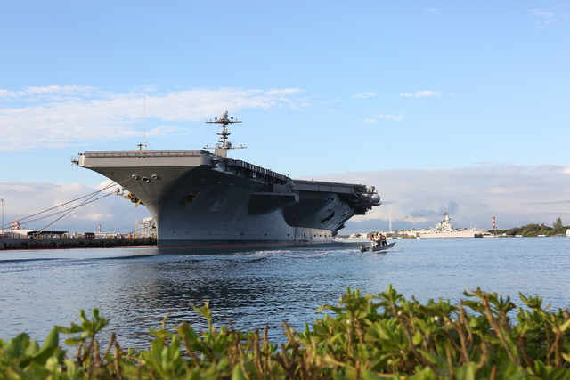 The aircraft carrier, USS John C. Stennis, moored across from Ford Island and the USS Missouri during the week long 75th Pearl Harbor Commemoration on the island of Oahu on Monday, December 5, 201 ...