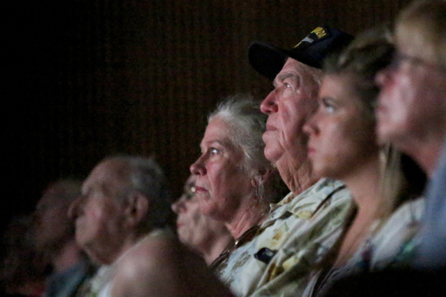 USS Nevada veteran Cliff Burks, center, watches a movie recounting the Dec. 7, 1941 surprise attack on Pearl Harbor with his daughter, Kerry Albritton, left, and grand-daughter Stescha Burks at th ...
