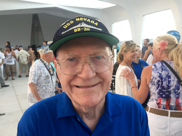 Dick Ramsey poses for a photograph at the USS Arizona Memorial during a tour Monday, Dec. 5, 2016, of Pearl Harbor, Hawaii to commemorate the 75th anniversary of the attack by Japanese warplanes t ...