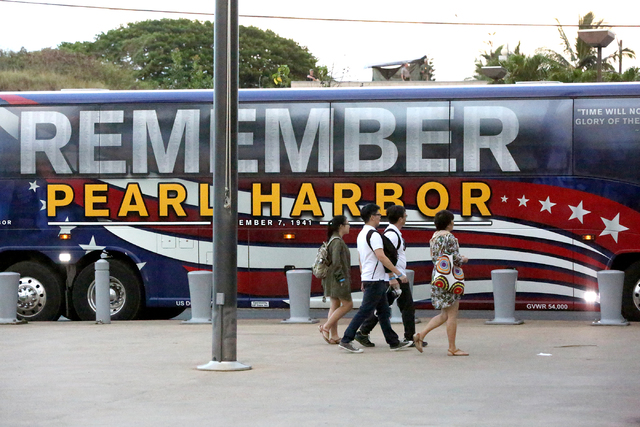 Guests to the Pearl Harbor Visitors Center during the 75th Commemorative events at the national park head for their tour bus on Monday, December 5, 2016. (Michael Quine/Las Vegas Review-Journal) @ ...