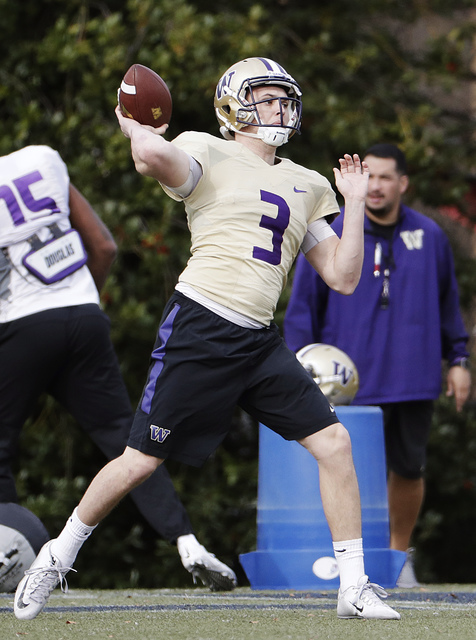 Washington quarterback Jake Browning throws a pass during a Peach Bowl NCAA college football practice in Atlanta, Wednesday, Dec. 28, 2016. Alabama and Washington will face off in the Peach Bowl f ...