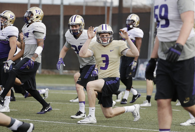 Washington quarterback Jake Browning (3) warms up with teammates during a Peach Bowl NCAA college football practice in Atlanta, Wednesday, Dec. 28, 2016. Alabama and Washington will face off in th ...