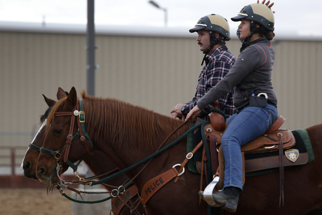 Tim Ruiz, 36, left, and Maile Hanks, 29, listens to an instructor during training at the Mounted Unit training facility on Friday, Dec. 30, 2016, in Las Vegas. (Christian K. Lee/Las Vegas Review-J ...