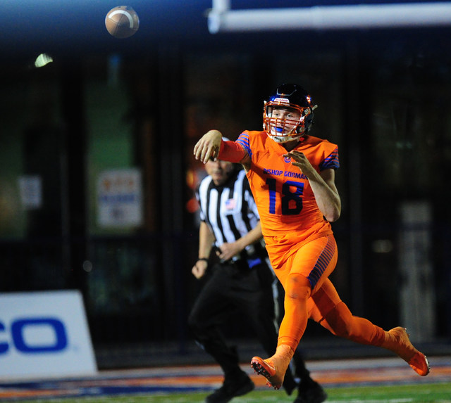 Bishop Gorman quarterback Tate Martell passes while on the run against St. Thomas Aguinas, Fla.  in the first half of their prep football game at Bishop Gorman High School in Las Vegas Friday, Sep ...