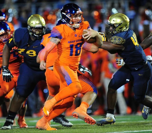 Bishop Gorman quarterback Tate Martell rushes for a first down against St. Thomas Aguinas, Fla.  in the first half of their prep football game at Bishop Gorman High School in Las Vegas Friday, Sep ...