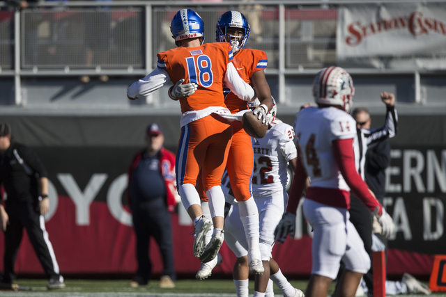 Brevin Jordan (9) celebrates his touchdown with Tate Martell (18) against Liberty in the Class 4A state football championship game at Sam Boyd Stadium on Saturday, Dec. 3, 2016, in Las Vegas. Bish ...