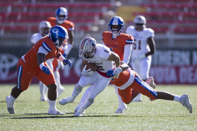 Liberty's Ethan Dedeaux (2) is tackled by Bishop Gorman after a catch in the Class 4A state football championship game at Sam Boyd Stadium on Saturday, Dec. 3, 2016, in Las Vegas. Bishop Gorman wo ...
