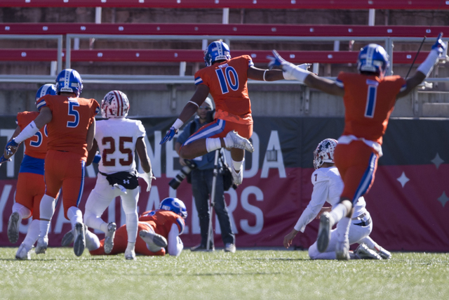 Bishop Gorman players celebrate a touchdown by Austin Arnold (6) against Liberty in the Class 4A state football championship game at Sam Boyd Stadium on Saturday, Dec. 3, 2016, in Las Vegas. Bisho ...