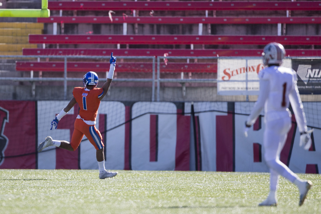Bishop Gorman's Greg Francis (1) celebrates a touchdown by Austin Arnold (6) against Liberty in the Class 4A state football championship game at Sam Boyd Stadium on Saturday, Dec. 3, 2016, in Las  ...