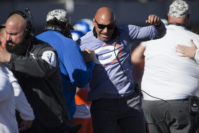Bishop Gorman's head football coach Kenny Sanchez greets a fellow coach before their game against Liberty in the Class 4A state football championship game at Sam Boyd at Sam Boyd Stadium on Saturd ...