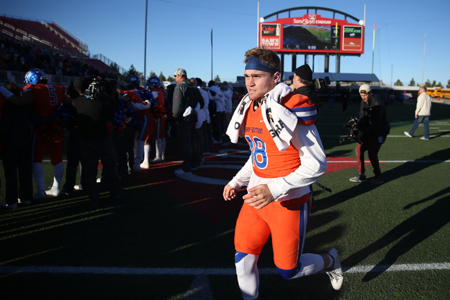Bishop Gorman's Tate Martell (18) runs to meet with his teammates after winning 84-8 against Liberty in the Class 4A state football championship game at Sam Boyd Stadium on Saturday, Dec. 3, 2016, ...