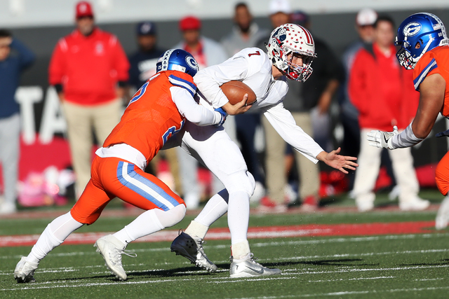 Bishop Gorman's Tyjon Lindsey (25) sacks Liberty's Kenyon Oblad (7) in the Class 4A state football championship game at Sam Boyd Stadium on Saturday, Dec. 3, 2016, in Las Vegas. Bishop Gorman won  ...