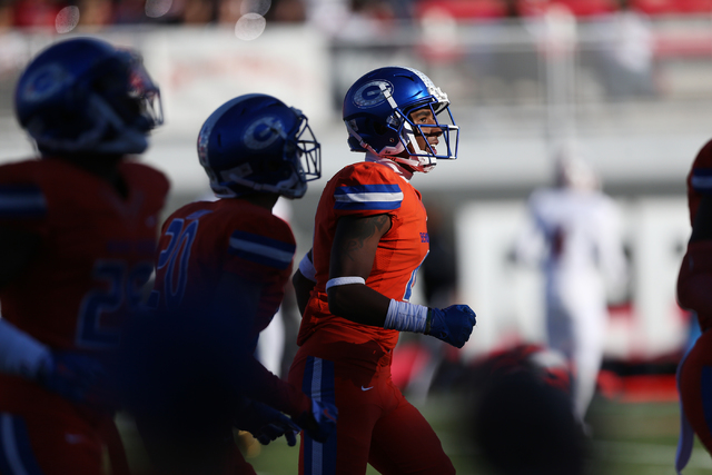 Bishop Gorman's Alex Perry (4), center, after scoring a touchdown against Liberty during the Class 4A state football championship game at Sam Boyd Stadium on Saturday, Dec. 3, 2016, in Las Vegas.  ...