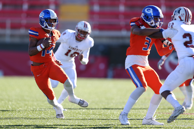 Bishop Gorman's Dorian Thompson-Robinson (14) runs the ball against Liberty in the Class 4A state football championship game at Sam Boyd Stadium on Saturday, Dec. 3, 2016, in Las Vegas. Bishop Gor ...