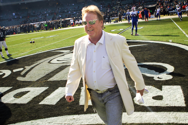 Mark Davis, owner and managing general partner of the Oakland Raiders,  talks to current