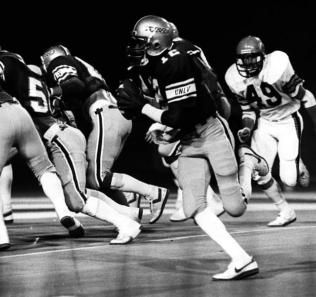 UNLV quarterback Randall Cunningham rolls out while running a play against Idaho State during a football game in Las Vegas in 1984. (Wayne C. Kodey/Las Vegas Review-Journal)
