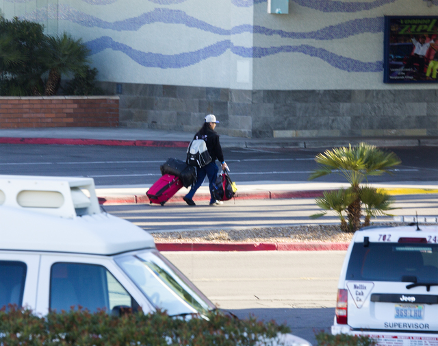 A man walks with luggage in the driveway of the Rio on Thursday, Dec. 29, 2016. The resort was evacuated after another electrical fire broke out Thursday morning. (Jeff Scheid/Las Vegas Review-Jou ...