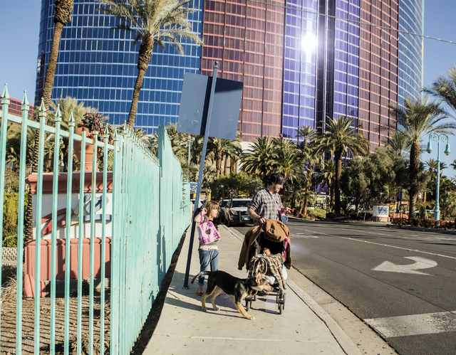 A family waits for a ride on Thursday, Dec. 29, 2016, near the Rio. The resort was evacuated after another electrical fire broke out Thursday morning. (Jeff Scheid/Las Vegas Review-Journal) @jeffs ...