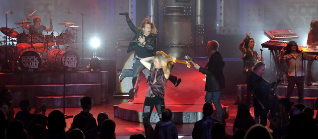 """Cast members perform during """"Raiding the Rock Vault"""" in the showroom at the Tropicana hotel-casino at 3801 Las Vegas Blvd., South, in Las Vegas on Saturday, Nov. 8, 2014. (Bill H ..."""