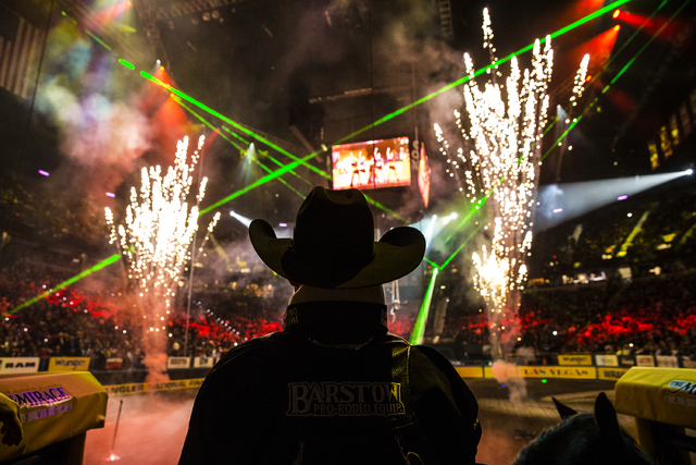 Bareback rider Jesse Davis watches opening ceremonies during the ninth day of the National Finals Rodeo at the Thomas & Mack Center on Friday, Dec. 9, 2016, in Las Vegas. (Benjamin Hager/Las V ...