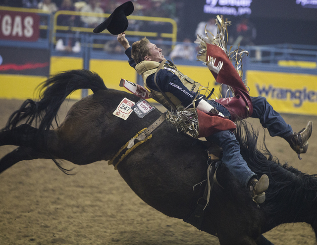Ty Breuer rides True Grit during the bareback riding competition on the ninth day of the National Finals Rodeo at the Thomas & Mack Center on Friday, Dec. 9, 2016, in Las Vegas. (Benjamin Hage ...
