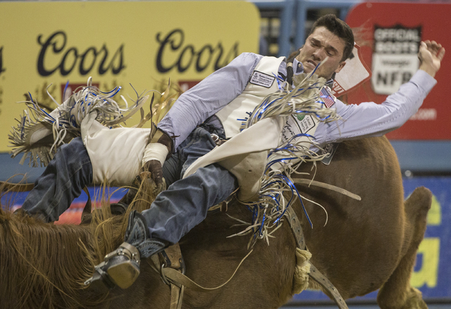 Caleb Bennett rides Pass the Hat during the bareback riding competition during the ninth day of the National Finals Rodeo at the Thomas & Mack Center on Friday, Dec. 9, 2016, in Las Vegas. (Be ...