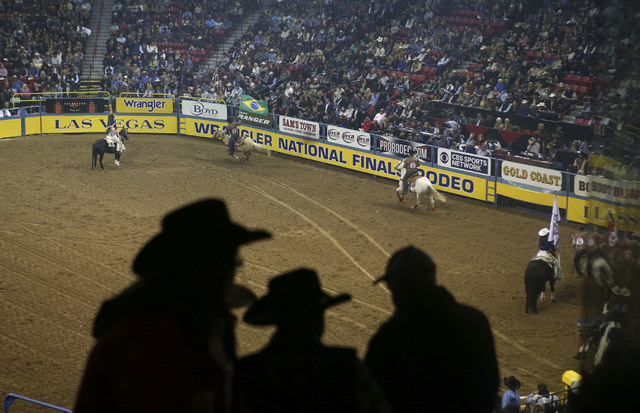 Attendees take their seats at the start of the 2nd go-round of the National Finals Rodeo at the Thomas & Mack Center in Las Vegas on Friday, Dec. 2, 2016. (Chase Stevens/Las Vegas Review-Journ ...