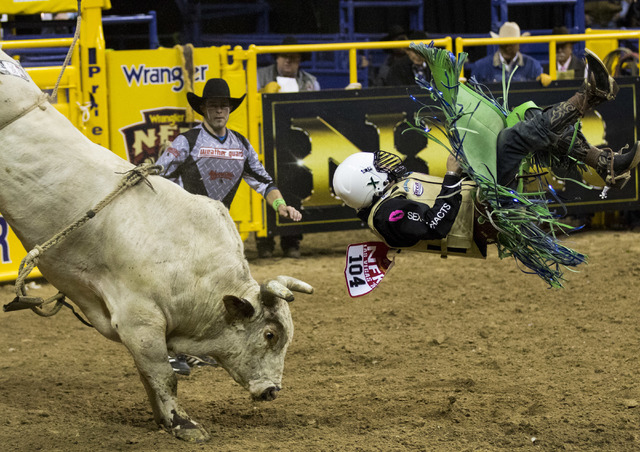 Jordan Spears (104) competes in the bull riding competition during opening day of National Finals Rodeo at the Thomas & Mack Center on Thursday, Dec. 1, 2016. (Miranda Alam/Las Vegas Review-Jo ...