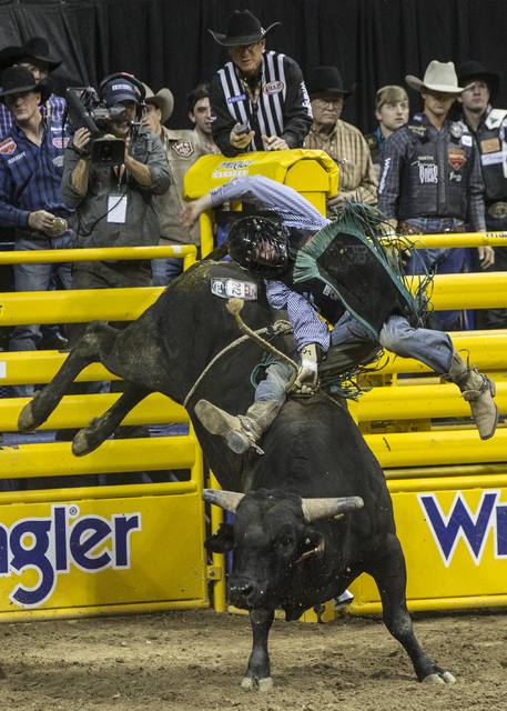 Garrett Tribble rides Psycho Path during the bull riding competition at the National Finals Rodeo at the Thomas & Mack Center on Tuesday, Dec. 6, 2016, in Las Vegas. Benjamin Hager/Las Vegas R ...