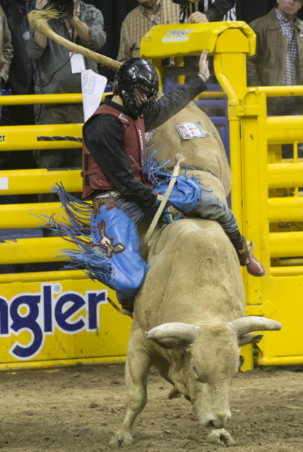 Roscoe Jarboe rides Yellow Fever during the bull riding competition at the National Finals Rodeo at the Thomas & Mack Center on Tuesday, Dec. 6, 2016, in Las Vegas. Benjamin Hager/Las Vegas Re ...